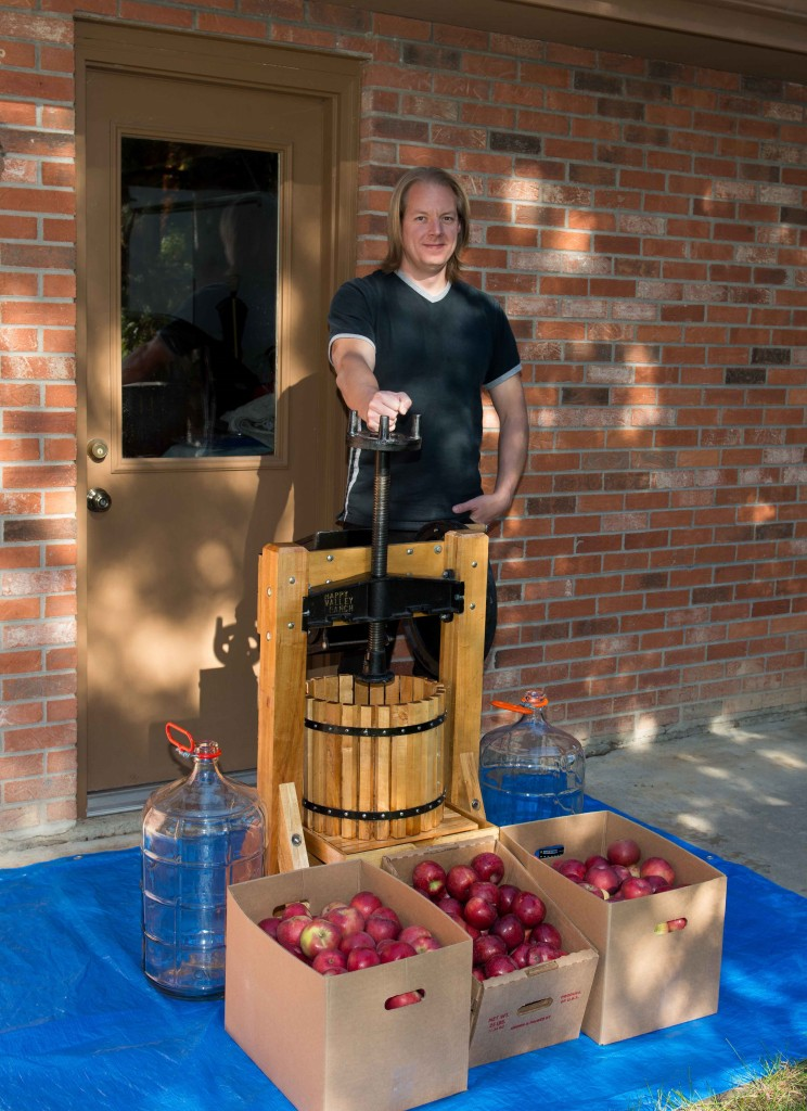 Yours truly with press, carboys, and Winesap and Rome apples.