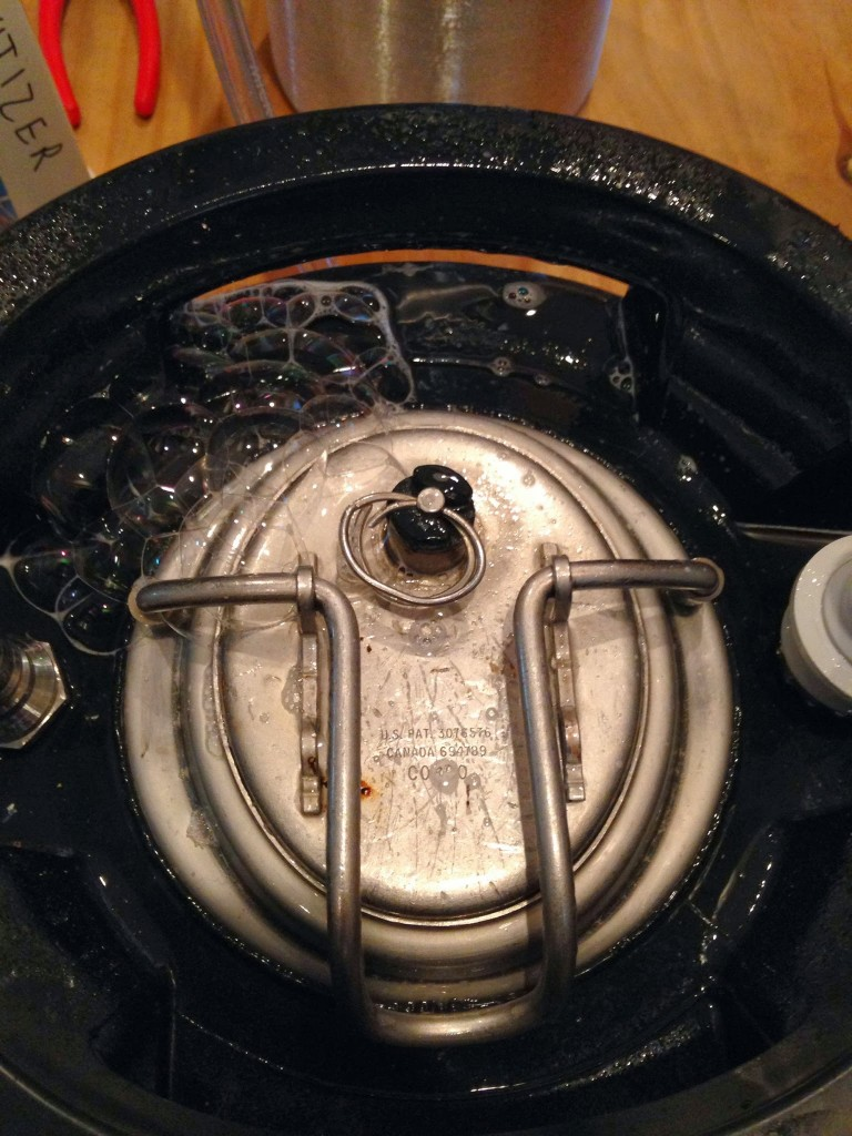 CO2 escaping from poorly-seated keg lid.