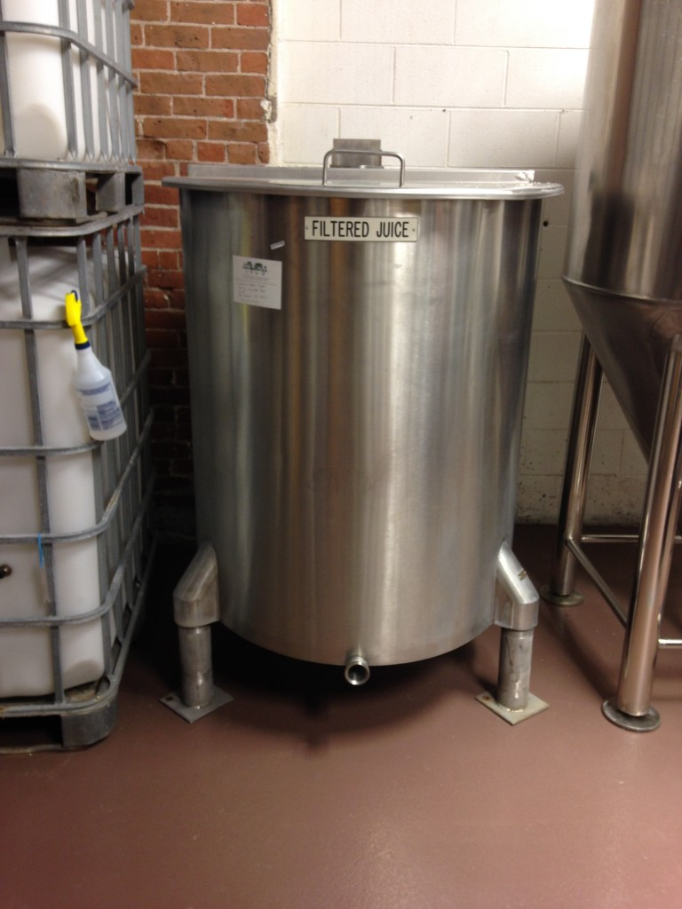 Open-top mixing tank for blending juices pre-fermentation.