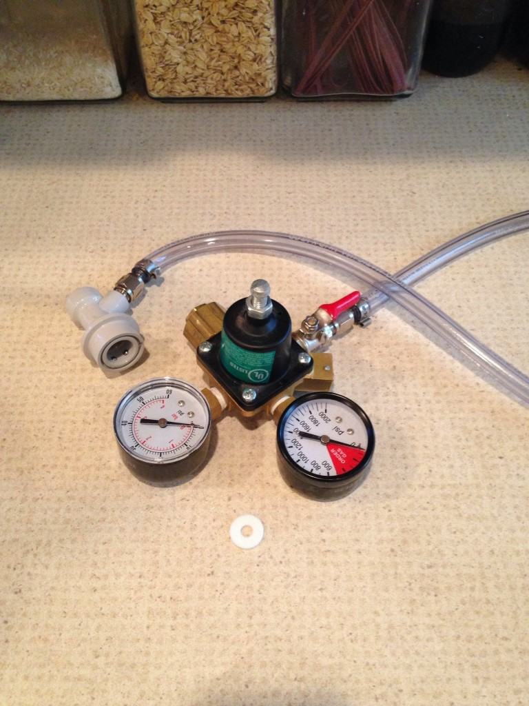Regulator with connect hose attached at shutoff valve (red); with plastic washer.